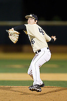Wake Forest Demon Deacons relief pitcher John McCarren (45) in action against the Cincinnati Bearcats at Wake Forest Baseball Park on February 21, 2014 in Winston-Salem, North Carolina.  The Bearcats defeated the Demon Deacons 5-0.  (Brian Westerholt/Four Seam Images)