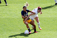 SANDY, UT - SEPTEMBER 26: Lo'eau LaBonta #9 of Utah Royals FC and Morgan Andrews #12 of OL Reign FC battle for the ball during a game between OL Reign and Utah Royals FC at Rio Tinto Stadium on September 26, 2020 in Sandy, Utah.