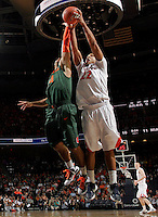 CHARLOTTESVILLE, VA- JANUARY 7: Malcolm Brogdon #22 of the Virginia Cavaliers reaches for the rebound with Trey McKinney Jones #4 of the Miami Hurricanes during the game on January 7, 2012 at the John Paul Jones Arena in Charlottesville, Virginia. Virginia defeated Miami 52-51. (Photo by Andrew Shurtleff/Getty Images) *** Local Caption *** Malcolm Brogdon;Trey McKinney Jones