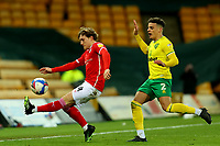 2nd January 2021; Carrow Road, Norwich, Norfolk, England, English Football League Championship Football, Norwich versus Barnsley; Callum Styles of Barnsley is under pressure from Max Aaron of Norwich City