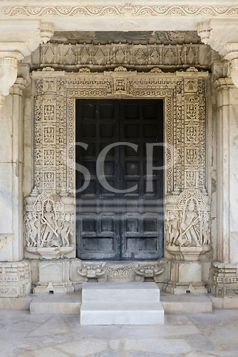 India; road from Udaipur to Jodhpur. Ranakpur Jain Temple. Doorway.