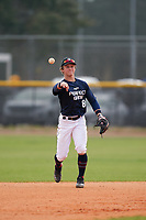 Shortstop Ely Kennel (8) throws the ball around in between innings during the Perfect Game National Underclass East Showcase on January 23, 2021 at Baseball City in St. Petersburg, Florida.  (Mike Janes/Four Seam Images)