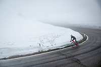 Natnael Tesfatsion (ERI/Androni Giocattoli - Sidermec) coming down the misty Passo Giau<br /> <br /> due to the bad weather conditions the stage was shortened (on the raceday) to 153km and the Passo Giau became this years Cima Coppi (highest point of the Giro).<br /> <br /> 104th Giro d'Italia 2021 (2.UWT)<br /> Stage 16 from Sacile to Cortina d'Ampezzo (shortened from 212km to 153km)<br /> <br /> ©kramon