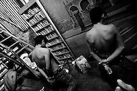 Young men, supposed gang members, kneel on the floor handcuffed and detained by Police in San Salvador, El Salvador, 19 May 2011. During the last two decades, Central America has become the deadliest region in the world that is not at war. According to the UN statistics, more people per capita were killed in El Salvador than in Iraq, in recent years. Due to the criminal activities of Mara Salvatrucha (MS-13) and 18th Street Gang (M-18), the two major street gangs in El Salvador, the country has fallen into the spiral of fear, violence and death. Thousands of Mara gang members, both on the streets or in the overcrowded prisons, organize and run extortions, distribution of drugs and kidnappings. Tattooed armed young men, mainly from the poorest neighborhoods, fight unmerciful turf battles with their coevals from the rival gang, balancing between life and death every day. Twenty years after the devastating civil war, a social war has paralyzed the nation of El Salvador.