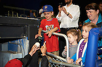 Young fan gets autographs from Batavia Muckdogs players after a game against the West Virginia Black Bears on June 28, 2016 at Dwyer Stadium in Batavia, New York.  Batavia defeated West Virginia 3-1.  (Mike Janes/Four Seam Images)