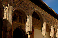 Colonnade and arches in the Patio de los Arrayanes area of Alhambra, a 14th-century palace in Granada, Andalusia, Spain.