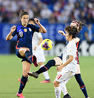 FRISCO, TX - MARCH 11: Carli Lloyd #10 of the United States battles for the ball with Mana Iwabuchi #8 of Japan during a game between Japan and USWNT at Toyota Stadium on March 11, 2020 in Frisco, Texas.