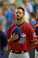 """Fort Myers Miracle pitcher Matt Borgschulte (30) stand for """"God Bless America"""" during the seventh inning stretch of a Florida State League game against the Charlotte Stone Crabs on April 6, 2019 at Charlotte Sports Park in Port Charlotte, Florida.  Fort Myers defeated Charlotte 7-4.  (Mike Janes/Four Seam Images)"""
