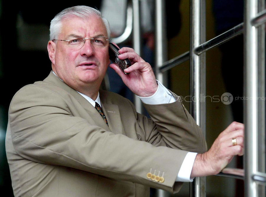Former Fianna Fail TD Liam Lawlor on a mobile phone outside the Mahon Tribunal at Dublin Castle. .22/7/2004.Photo: Gareth Chaney Collins
