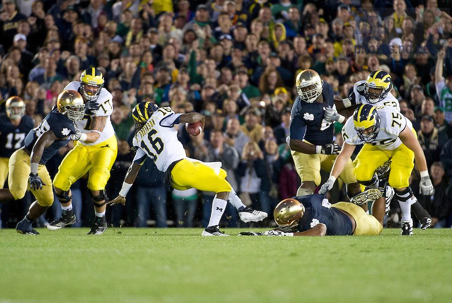 Sept. 22, 2012; Notre Dame defensive end Stephon Tuitt brings down Michigan quarterback Denard Robinson during the first quarter.  Photo by Barbara Johnston/University of Notre Dame
