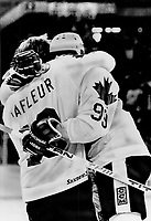 1981 FILE PHOTO - ARCHIVES -<br /> <br /> Great while it lasts: A few weeks from now; Guy Lafleur and Wayne Gretzky will be opponents again; but they're having fun now celebrating Team Canada goals; like Wayne's second last night<br /> <br /> PHOTO : Combs, Erin  - Toronto Star Archives - AQP