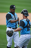 Syracuse Chiefs pitcher Jose Valverde (47) celebrates with catcher Dan Butler (12) after a victory against the Pawtucket Red Sox on July 6, 2015 at NBT Bank Stadium in Syracuse, New York.  Syracuse defeated Pawtucket 3-2.  (Mike Janes/Four Seam Images)