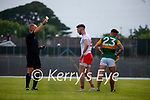 Matthew Donnelly, Tyrone, Micheál Burns, Kerry, receives a yellow card from Referee, Conor Lane during the Allianz Football League Division 1 Semi-Final, between Tyrone and Kerry at Fitzgerald Stadium, Killarney, on Saturday.