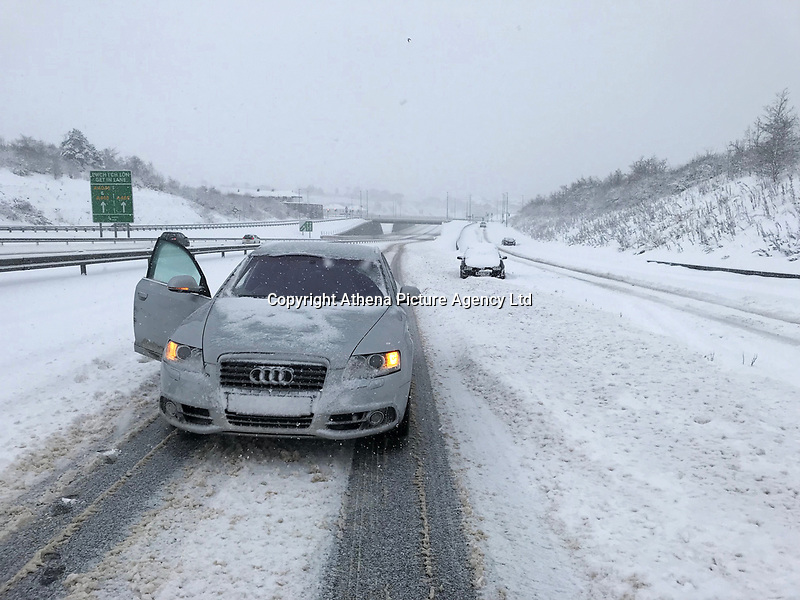 Cars abandoned at the side of the road after facing difficulties in travelling on the A465 Heads of Valleys road near Tredegar in south Wales, UK. Sunday 10 December 2017.
