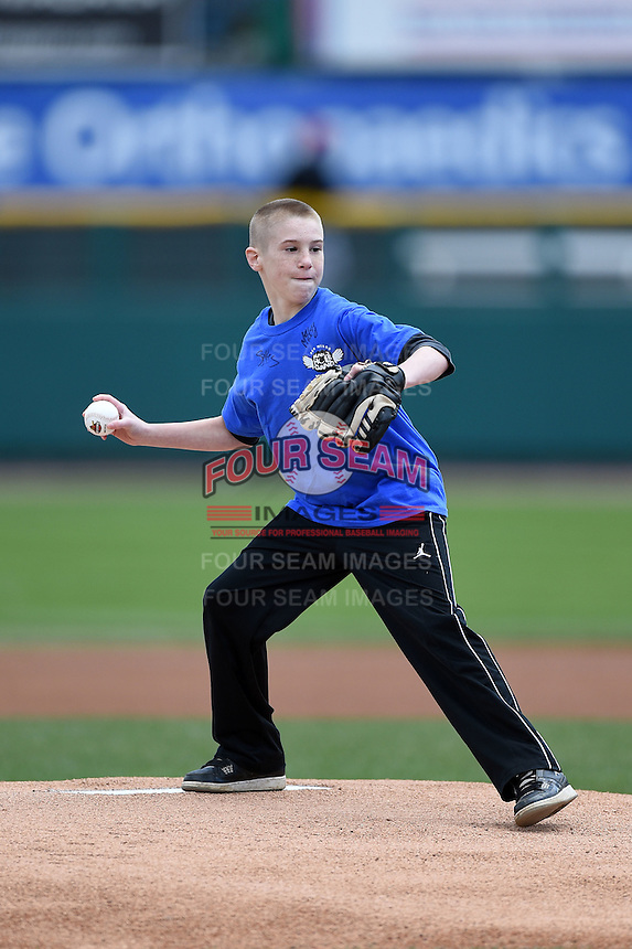 Rochester Red Wings knot hole gang member throws out the ceremonial first pitch before a game against the Louisville Bats on May 4, 2014 at Frontier Field in Rochester, New  York.  Rochester defeated Louisville 12-6.  (Mike Janes/Four Seam Images)
