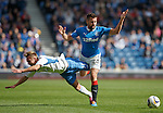 Iain Russell takes a tumble with Darren McGregor of Rangers closing in