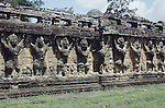 "Angkor Thom (Khmer: អង្គរធំ; literally: ""Great City""), located in present day Cambodia, was the last and most enduring capital city of the Khmer empire. It was established in the late twelfth century by King Jayavarman VII. It covers an area of 9 km², within which are located several monuments from earlier eras as well as those established by Jayavarman and his successors. At the centre of the city is Jayavarman's state temple, the Bayon, with the other major sites clustered around the Victory Square immediately to the north."