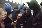Riots rioting Catholic youth attacking the British army Belfast Northern Ireland Uk 1980s