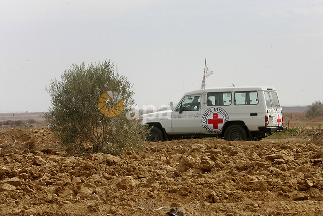 Vehicle of International Committee of the Red Cross (ICRC) driven, as the comittee assists Palestinian farmers to repair their fields that were devastated during the Israeli army summer's military offensive on the Gaza Strip on October 22, 2014, in Khan Yunis' Khuzaa neighbourhood in the southern Gaza Strip near the Israeli border. Photo by Abed Rahim Khatib