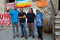 """(From L to R) De Magistris (Naples), Lucano (Riace), Colau (Barcelona) & Alex Zanotelli.<br /> <br /> Riace (Calabria, Italy), 04/08/2018. Visiting Riace for the third day of the """"Riace in Festival"""", 'Festival delle Migrazioni e delle Culture Locali' (Festival of Migration and Local Cultures). Attending the festival, amongst others, were the Mayor of Napoli Luigi De Magistris and the Mayor of Barcelona Ada Colau, debating with the Mayor of Riace, Domenico 'Mimmo' Lucano, about the so called """"migration crisis"""", as well as the now famous """"Modello Riace"""" (The Riace Model: how to welcome and work with Migrants to invest in building a future together). Other speakers included: Tiziana Barillà, Journalist at """"il Salto"""" (1) and Author of the book """"Mimi Capatosta. Mimmo Lucano e il modello Riace"""" (2), Magistrates Riccardo De Vito and Emilio Sirianni (in turn President and Member of Magistratura Democratica). Chair of the event was Ilaria Bonaccorsi, Historian & Journalist at """"il Salto"""".<br /> From the Festival website: """"RIACE in FESTIVAL, is an event born in the wake of the policy of reception and resettlement of refugees and asylum seekers that the city administration of the """"Riace Bronzes'"""" town has been implementing for years. [...] The festival aims to be a concrete initiative that, through the universal language of cinema and the arts, promotes the exchange and mutual knowledge to counteract forms of closure and racism, drawing attention to the innovative path that the municipal administration of Riace has started by combining the reception of migrants with the revival of its territory and giving the image of an unpublished Calabria, different from that of the black chronicle>>.<br /> Riace is a small village in the province of Reggio Calabria. It's famous because on the 16 August 1972...<br /> <br /> (For the full caption read the ARTICLE at the the beginning of this story)"""