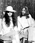 Beatles 1969 John Lennon and Yoko Ono at Heathrow Airport.© Chris Walter.