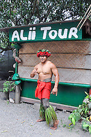 "A Samoan entertainer gives the ""shaka"" sign at MacNut farm, Alii Tour, Windward O'ahu."