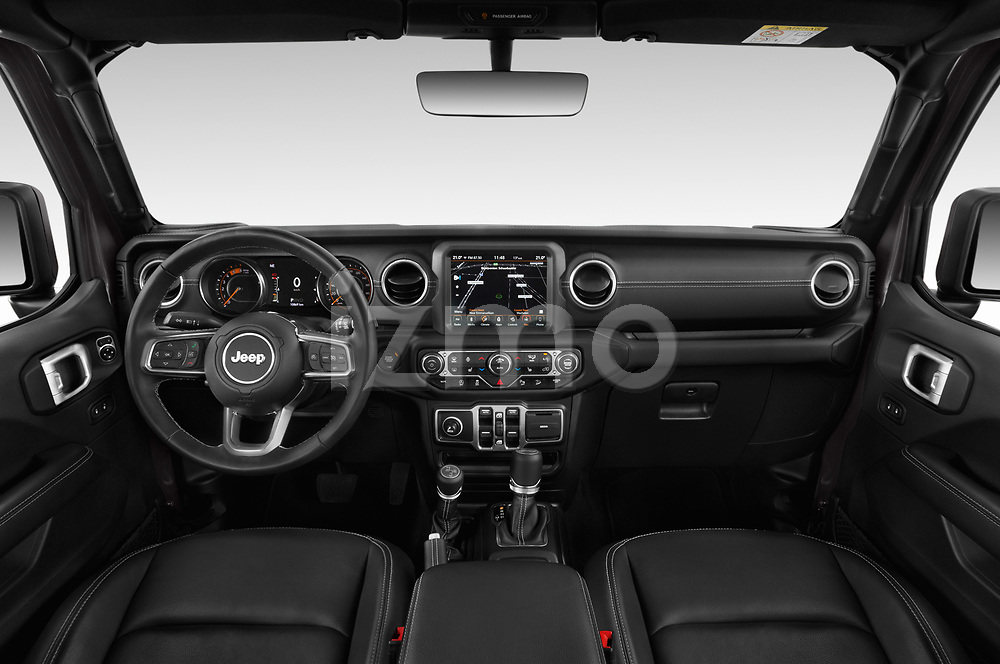 Stock photo of straight dashboard view of a 2019 Jeep Wrangler Unlimited Sahara 5 Door SUV