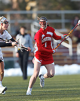 Boston University midfielder Jill Horka (1) on the attack. .Boston College (white) defeated Boston University (red), 12-9, on the Newton Campus Lacrosse Field at Boston College, on March 20, 2013.