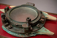 BNPS.co.uk (01202 558833)<br /> Pic: ZacharyCulpin/BNPS<br /> <br /> The salvaged Carpathia port hole that sold for £24,000<br /> <br /> Relics salvaged from the sunken ship that rescued the Titanic survivors have sold at auction for £135,000.<br /> <br /> The rare items included the engine room order telegraph the captain of the Carpathia used after he received the SOS from Titanic.<br /> <br /> He moved the handle to 'Full Steam Ahead', instructing staff in the engine room to rapidly increase speed