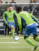 November, 2013: CenturyLink Field, Seattle, Washington: Seattle Sounders FC forward Clint Dempsey (2) passes the ball to Seattle Sounders FC forward Eddie Johnson (7)  as the Portland Timbers defeat  the Seattle Sounders FC 2-1 in the Major League Soccer Playoffs semifinals Round.