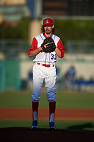 Stockton Ports starting pitcher Zack Erwin (33) prepares to deliver a pitch during a California League game against the Rancho Cucamonga Quakes at Banner Island Ballpark on May 16, 2018 in Stockton, California. Rancho Cucamonga defeated Stockton 6-3. (Zachary Lucy/Four Seam Images)