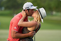 OLYMPIA FIELDS, IL - AUGUST 30: Jon Rahm celebrates with his wife, Kelley Cahill with a kiss after winning on the first sudden-death playoff hole against Dustin Johnson (not pictured) during the final round of the BMW Championship on the (North) Course at Olympia Fields Country Club