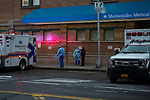 Medical workers take a break in front of the emergency room at Maimonides Medical Center on March 28, 2020 in Brooklyn, NY.  NYC's daily death toll from the coronavirus nearly tripled from the previous 24-hour period from 85 on Friday to 222 on Saturday.  Photograph by Michael Nagle/Redux