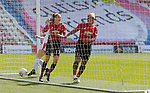 The ball flies across the goal for Lizzie Arnot of Manchester United Women to tap in for the goal...cele with Lauren James of Manchester United Women