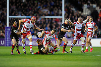 Greig Laidlaw of Gloucester Rugby offloads to Tom Palmer of Gloucester Rugby as he is tackled by Roddy Grant of Edinburgh Rugby