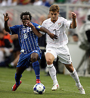 Robbie Rogers (7) battles for the ball with Walter Martinez (15).  The US Men's National Team defeated Honduras 2-0 in the semifinals of the Gold Cup at Soldier Field in Chicago, IL on July 23, 2009.