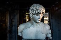 Anitinoo's head sculpture copy after greek model. Hadrianic period<br /> Marble. Origin: Rome, Via dei Fori Imperiali, previously in the garden of Villa Rivaldi (1933). Hall of the Machines. Centrale Montemartini.  Rome, Italy. Mar. 07, 2015