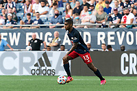 FOXBOROUGH, MA - AUGUST 8: Maciel #13 of New England Revolution dribbles at midfield during a game between Philadelphia Union and New England Revolution at Gillette Stadium on August 8, 2021 in Foxborough, Massachusetts.