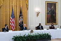 United States President Joe Biden holds a Cabinet Meeting in the East Room of the White House in Washington D.C. on Thursday, April 1, 2021.  President Biden announced that he is asking five cabinet members to explain his jobs plan to the American public.  Pictured from left to right: US Secretary of State Antony Blinken; President Biden; US Secretary of Defense Lloyd J. Austin III; and US Secretary of Commerce Gina Raimondo.<br /> CAP/MPI/RS<br /> ©RS/MPI/Capital Pictures