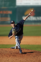 Wingate Bulldogs relief pitcher Riley Isenhour (21) delivers a pitch to the plate against the Catawba Indians at Newman Park on March 19, 2017 in Salisbury, North Carolina. The Indians defeated the Bulldogs 12-6. (Brian Westerholt/Four Seam Images)