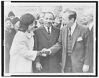1964 file photo - Mayor Wagner greets Dr. & Mrs. Martin Luther King, Jr. at City Hall / World Telegram & Sun photo by Phil Stanziola. Coretta Scott King shakes hands with New York City Mayor Robert Wagner as Dr. Martin Luther King, Jr. stands between them.