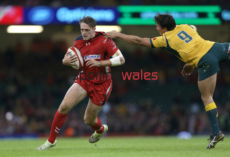 Wales replacement Cory Allen steps inside Australian scrum half Nick Phipps.<br /> Dove Men Series 2014<br /> Wales v Australia<br /> Millennium Stadium<br /> 08.11.14<br /> ©Steve Pope-SPORTINGWALES