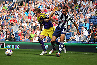 Sunday 01 September 2013<br /> Pictured L-R: Michu of Swansea challenged by Gareth McAuley.<br /> Re: Barclay's Premier League, West Bromwich Albion v Swansea City FC at The Hawthorns, Birmingham, UK.