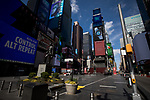 Empty streets and sidewalks are seen during the coronavirus pandemic in the Times Square neighborhood of New York, U.S., on Wednesday, April 1, 2020.  Photograph by Michael Nagle