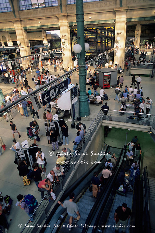 Crowds of people arriving and departing from Gare du Nord, Paris, France.