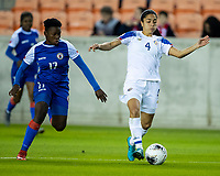 HOUSTON, TX - JANUARY 31: Mariana Benavides #4 of Costa Rica advances the ball with Mikerline Saintfelix #17 of Haiti in pursuit during a game between Haiti and Costa Rica at BBVA Stadium on January 31, 2020 in Houston, Texas.