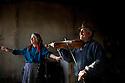 Kolarovo, Bulgaria--Anka Koleva, 72, left, dances while her husband, Ivan Kolev, 73, plays the violin in their home. They are elders in the Kalaidzhi community near Stara Zagora in Central Bulgaria.