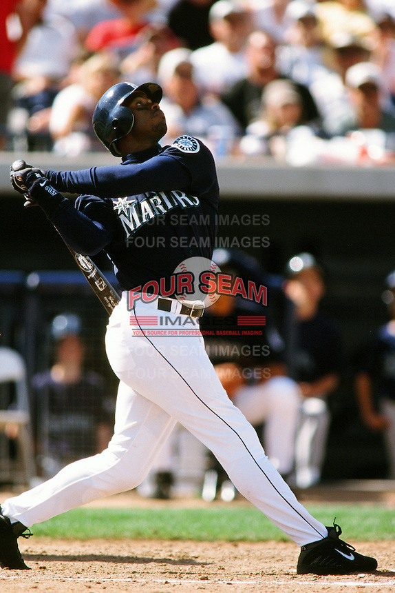 Ken Griffey jr. of the Seattle Mariners during a Spring Training game  at the Peoria Sports Complex circa 1999 in Anaheim, California. (Larry Goren/Four Seam Images)