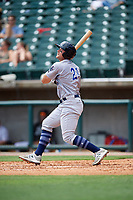 Pensacola Blue Wahoos left fielder Brian O'Grady (21) follows through on a swing during a game against the Birmingham Barons on May 9, 2018 at Regions Field in Birmingham, Alabama.  Birmingham defeated Pensacola 16-3.  (Mike Janes/Four Seam Images)