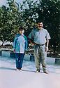 Syria 1994.Damascus: New young recruit with Abdulla Ocalan  Syrie 1994 A Damas,jeune femme, nouvelle recrue du PKK, pose avec Abdullah Ocalan, chef du PKK